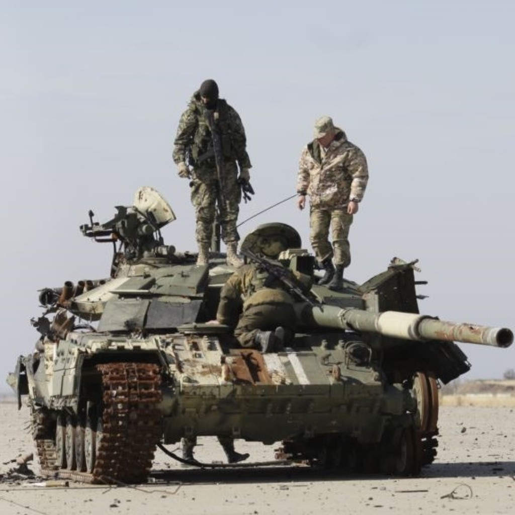 epa04976286 Pro-Russian separatists inspect a damaged tank at the destroyed International Airport in Donetsk, 13 October 2015. The Dutch Safety Board in The Netherlands on the same day was presenting its final report into the downing of Malaysia Airlines flight MH17 over eastern Ukraine last year. The MH17 flight was on its way from Amsterdam to Kuala Lumpur when it went down in rebel-controlled territory on 17 July 2014, killing all 298 people on board.  EPA/ALEXANDER ERMOCHENKO