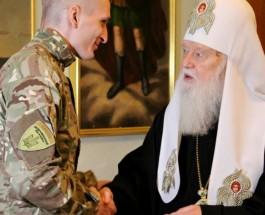 Патриарх Филарет наградил воевавших на Донбассе добровольцев из России и Беларуси